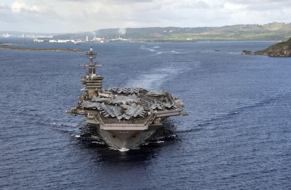 PHILIPPINE SEA (June 4, 2020)In this June 4, 2020, photo provided by the U.S. Navy, the aircraft carrier USS Theodore Roosevelt (CVN 71) departs Apra Harbor in Guam. The carrier has returned to sea and is conducting military operations in the Pacific region, 10 weeks after a massive coronavirus outbreak sidelined Navy warship. (Mass Communication Specialist Seaman Kaylianna Genier/U.S. Navy via AP))
