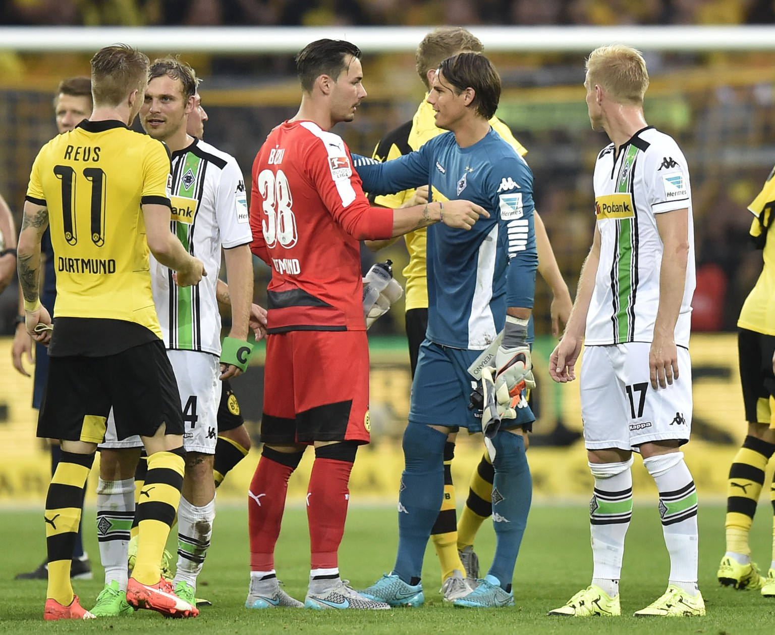 Swiss goalkeepers Roman Buerki of Dortmund, left, and Yann Sommer of Moenchengladbach, right, talk after the German Bundesliga soccer match between Borussia Dortmund and Borussia Moenchengladbach in Dortmund, Germany, Saturday, Aug. 15, 2015. Dortmund defeated Moenchengladbach  4-0. (AP Photo/Martin Meissner)
