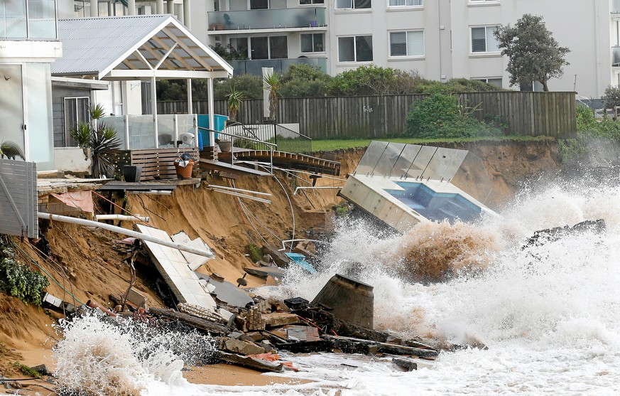 A wave crashes against a swimming pool and properties after they were damaged by severe weather, which brought strong winds and heavy rain to the east coast of Australia, at Collaroy beach in Sydney, June 6, 2016.       AAP/David Moir/REUTERS     ATTENTION EDITORS - THIS IMAGE WAS PROVIDED BY A THIRD PARTY. EDITORIAL USE ONLY. NO RESALES. NO ARCHIVE. AUSTRALIA OUT. NEW ZEALAND OUT.