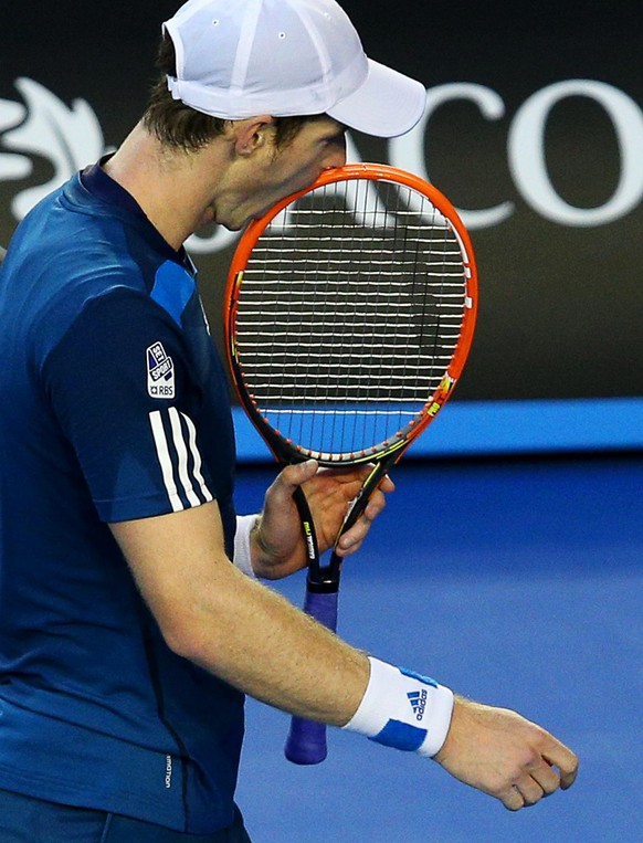 epa04035942 Andy Murray of Britain reacts during his quarter final match against Roger Federer of Switzerland at the Australian Open Grand Slam tennis tournament in Melbourne, Australia, 22 January 2014.  EPA/MARK DADSWELL AUSTRALIA AND NEW ZEALAND OUT