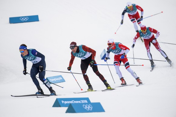 Dario Cologna of Switzerland, 2nd left, in action during the men Cross Country Skiing 15 km + 15 km Skiathlon during the XXIII Winter Olympics 2018 at the Alpensia Cross-Country Skiing Centre in Pyeongchang, South Korea, on Sunday, February 11, 2018. (KEYSTONE/Jean-Christophe Bott)