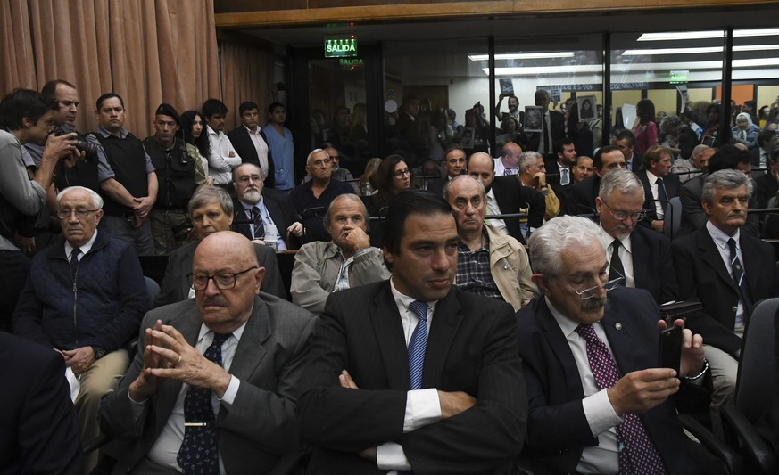 epa06358393 The ex-military Jorge Eduardo Acosta (second row-L) and Alfredo Astiz (second row-2-L) listen to the reading of the verdict, at the federal courts of Buenos Aires, Argentina, 29 November 2017.  Former military officials, Jorge Eduardo Acosta and Alfredo Astiz were sentenced to life imprisonment in a trial for crimes against humanity in Argentina and which has focused on crimes committed at the Navy Petty-Officers School of Mechanics (ESMA) during the last dictatorship (1976-1983).  EPA/Downes Florencia