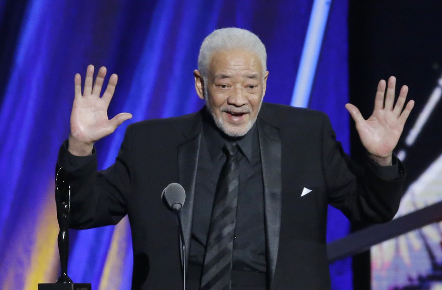 "FILE - This April 18, 2015 file photo shows singer-songwriter Bill Withers speaking at the Rock and Roll Hall of Fame Induction Ceremony in Cleveland. Withers, who wrote and sang a string of soulful songs in the 1970s that have stood the test of time, including ""Lean On Me,"" ""Lovely Day"" and ""Ain't No Sunshine,"