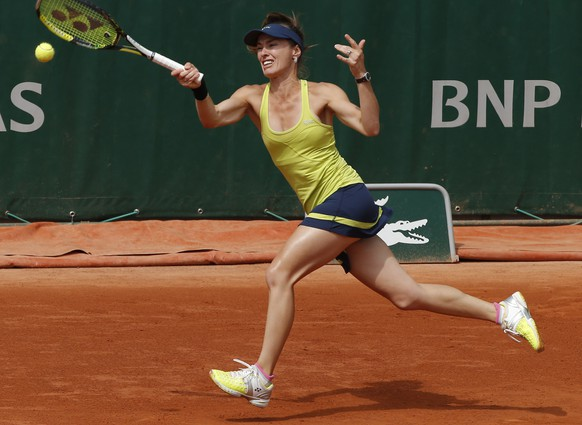 Martina Hingis of Switzerland returns the ball as she plays with Sania Mirza of India against  Stephanie Foretz and Amandine Hesse of France  during their second round match of the French Open tennis tournament at the Roland Garros stadium, Friday, May 29, 2015 in Paris. (AP Photo/Michel Euler)