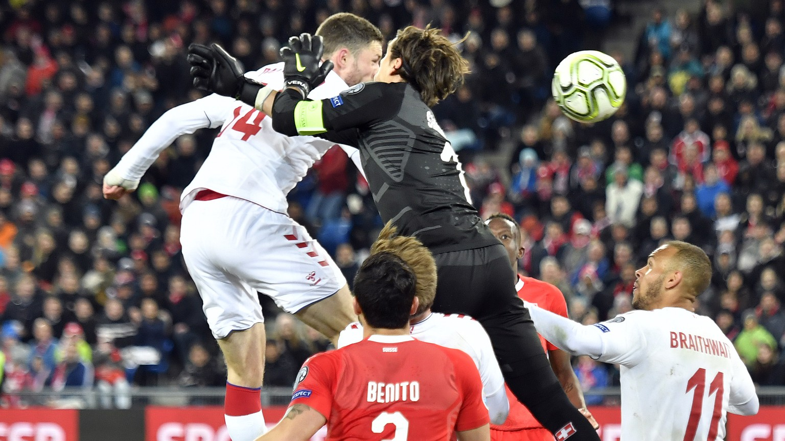 epa07465730 Denmark's Henrik Dalsgaard, left, scores the 3-3 against Switzerland's goalkeeper Yann Sommer, right, during the UEFA Euro 2020 qualifying Group D soccer match between Switzerland and Denmark at the St. Jakob-Park stadium in Basel, Switzerland, 26 March 2019.  EPA/WALTER BIERI