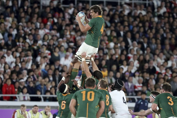 South Africa's Eben Etzebeth catches a ball in a lineout during the Rugby World Cup final between England and South Africa at International Yokohama Stadium in Yokohama, Japan, Saturday, Nov. 2, 2019. (AP Photo/Eugene Hoshiko)