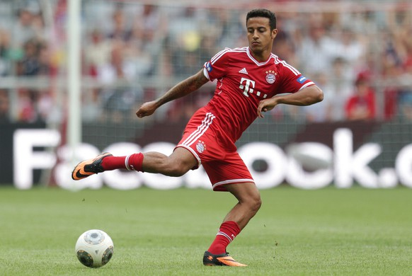 New Bayern Munich player Thiago Alcantara of Spain attends a training session after a public team presentation in the Allianz Arena stadium in Munich, southern Germany, on Tuesday, July 23, 2013. (AP Photo/Matthias Schrader)