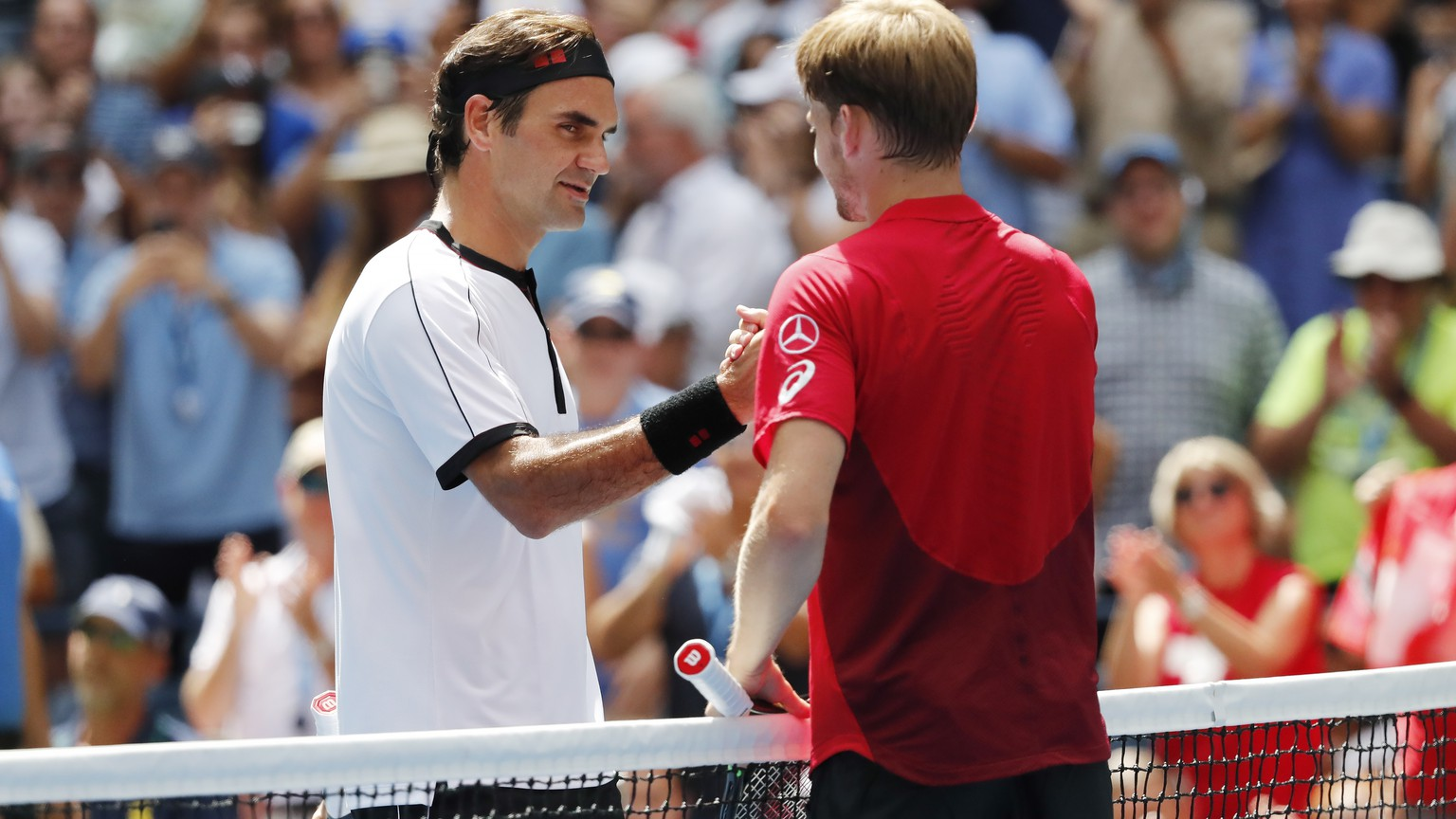 epa07811009 Roger Federer of Switzerland and David Goffin of Belgium after their match on the seventh day of the US Open Tennis Championships the USTA National Tennis Center in Flushing Meadows, New York, USA, 01 September 2019. The US Open runs from 26 August through 08 September.  EPA/JOHN G. MABANGLO