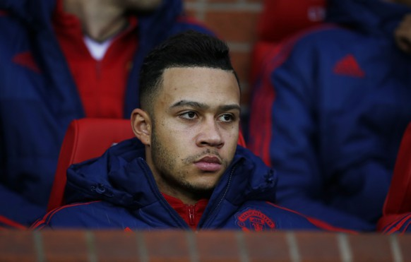 """Football Soccer - Manchester United v West Ham United - Barclays Premier League - Old Trafford - 5/12/15 Manchester United's Memphis Depay on the substitutes bench Reuters / Andrew Yates Livepic EDITORIAL USE ONLY. No use with unauthorized audio, video, data, fixture lists, club/league logos or """"live"""" services. Online in-match use limited to 45 images, no video emulation. No use in betting, games or single club/league/player publications.  Please contact your account representative for further details."""