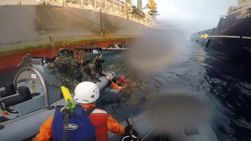 epa04491276 A handout video grab made available by Greenpeace on 15 November 2014 shows Spanish Navy members rescuing a member of Greenpeace after she was allegedly injured in an incident during a demonstration against drilling activities, in the Canary Islands, Spain, 15 November 2014. The environmental protection group accused the military of ramming its motorboats and posted a video of the operation online. The Defence Ministry in Madrid denied the accusations.  EPA/GREENPEACE / HANDOUT BEST QUALITY AVAILABLE HANDOUT EDITORIAL USE ONLY/NO SALES