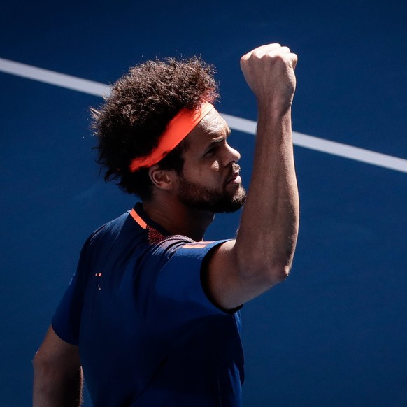 epa05733085 Jo-Wilfried Tsonga of France reacts during round three of the Men's Singles match against Jack Sock of the USA at the Australian Open Grand Slam tennis tournament in Melbourne, Australia, 20 January 2017.  EPA/MARK R. CRISTINO