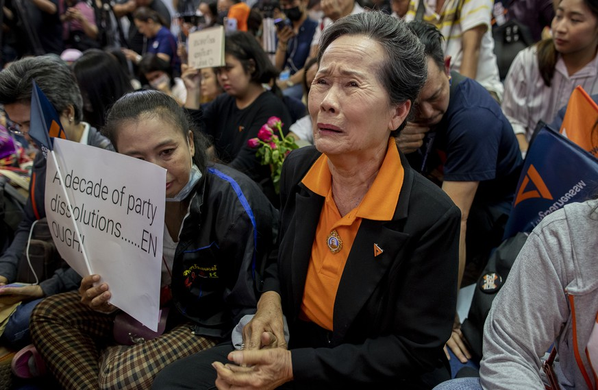 A supporter of Thailand's Future Forward Party cries as they watch a live television broadcast of a court verdict at their party's headquarters in Bangkok, Thailand, Friday, Feb. 21, 2020. Thailand's Constitutional Court on Friday ordered the popular opposition Future Forward Party dissolved, declaring that it violated election law by accepting a loan from its leader. The court also imposed a 10-year ban on the party's executive members holding political office. (AP Photo/Gemunu Amarasinghe)