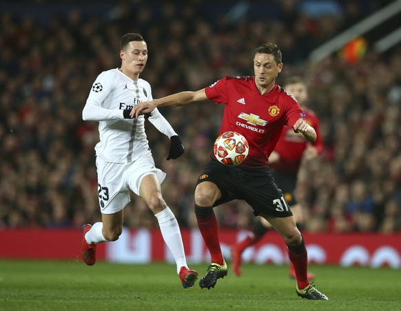 Manchester United's Nemanja Matic, right vies for the ball with Paris Saint Germain's Julian Draxler during the Champions League round of 16 soccer match between Manchester United and Paris Saint Germain at Old Trafford stadium in Manchester, England, Tuesday, Feb. 12, 2019. (AP Photo/Dave Thompson)