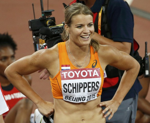 Dafne Schippers of Netherlands celebrates winning the women's 200 metres heats during the 15th IAAF World Championships at the National Stadium in Beijing, China August 26, 2015.  REUTERS/Kim Kyung-Hoon