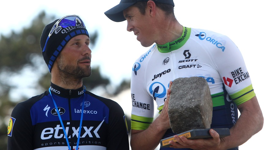 Matthew Ayman of Australia, Oreca Team, right,  celebrates with his trophy on the podium after he won the the Paris-Roubaix cycling classic, a 257.5 kilometer (160 mile) one day race, with about 20 per cent of the distance run on cobblestones, at the velodrome in Roubaix, northern France, on Sunday, April 10, 2016. Belgium's Tom Boonen, left, of the team Quick Step came second.(AP Photo/Michel Spingler)