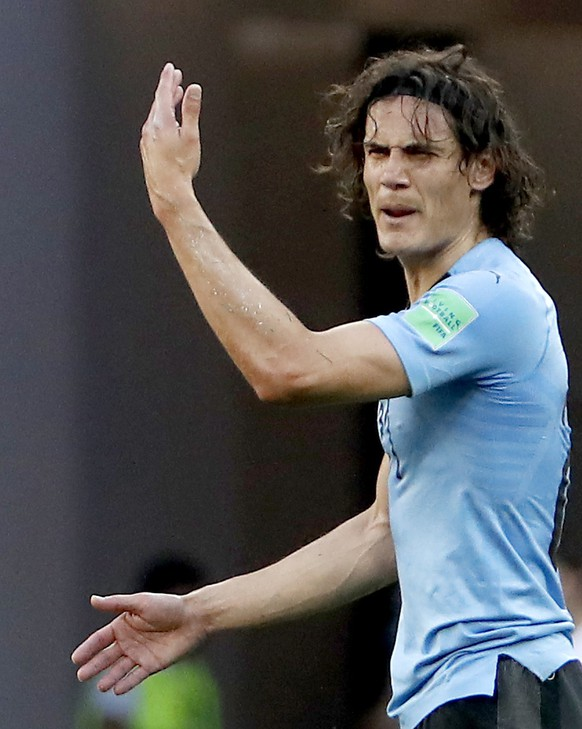 epa06824885 Edinson Cavani of Uruguay reacts during the FIFA World Cup 2018 group A preliminary round soccer match between Uruguay and Saudi Arabia in Rostov-On-Don, Russia, 20 June 2018.  (RESTRICTIONS APPLY: Editorial Use Only, not used in association with any commercial entity - Images must not be used in any form of alert service or push service of any kind including via mobile alert services, downloads to mobile devices or MMS messaging - Images must appear as still images and must not emulate match action video footage - No alteration is made to, and no text or image is superimposed over, any published image which: (a) intentionally obscures or removes a sponsor identification image; or (b) adds or overlays the commercial identification of any third party which is not officially associated with the FIFA World Cup)  EPA/SHAWN THEW   EDITORIAL USE ONLY
