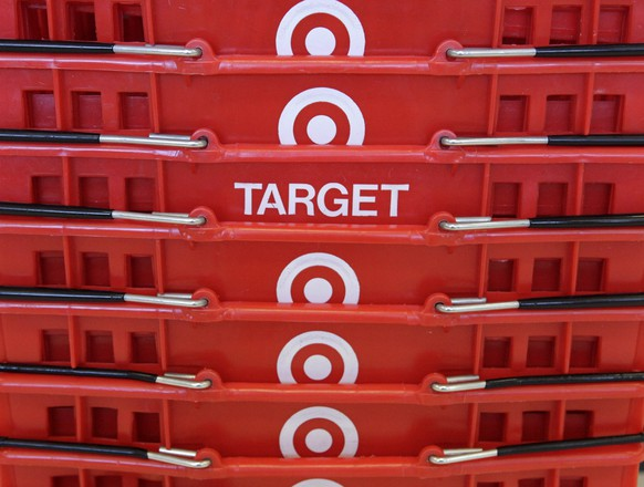 FILE - In this May 20, 2009 file photo, shopping baskets are stacked at a Chicago area Target store. Target Corp. on Tuesday, March 3, 2015 said it plans $2 billion in cost cuts over the next two years through corporate restructuring and other improvements. (AP Photo/Charles Rex Arbogast, File)
