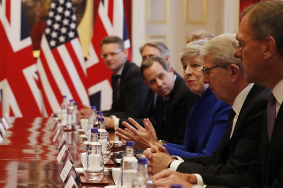 British Prime Minister Theresa May, center, speaks during a business roundtable event with President Donald Trump at St. James's Palace, Tuesday, June 4, 2019, in London. (AP Photo/Alex Brandon)