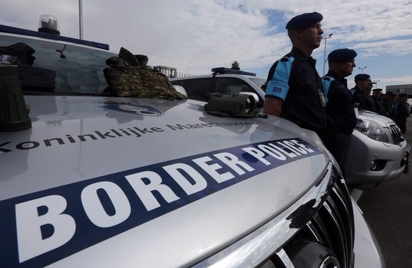 epa07468431 (FILE) - Police officers of European Border and Coast Guard stand on duty, during the official launch of the European Border and Coast Guard, in Kapitan Andreevo Check Point, on the borders of Bulgaria with Turkey, 06 October 2016 (reissued 28 March 2019). To protect Europe's external borders, the EU's Frontex border patrol force is to be expanded to up to 10,000 troops by 2027, according to announcements by participants in the negotiations between EU states and the European Parliament on 28 March 2019.  EPA/ORESTIS PANAGIOTOU