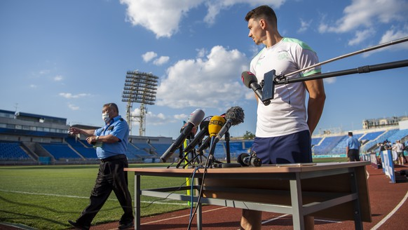 Switzerland's midfielder Christian Fassnacht, speaks to journalists after a training session for the UEFA Euro 2020 soccer tournament, at the Petrovsky stadium, in St. Petersburg, Russia, Wednesday, June 30, 2021. Switzerland will face Spain in their UEFA EURO 2020 quarterfinal soccer match on July 2, 2021 in St. Petersburg, Russia. (KEYSTONE/Jean-Christophe Bott)