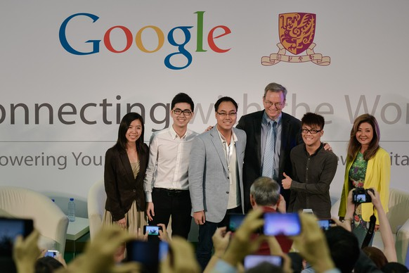 Executive Chairman of Google Eric Schmidt (2nd-R) poses with young entrepreneurs at the Chinese University in Hong Kong on November 4, 2013. Schmidt shared his insight on entrepreneurship and engaged in a conversation with local students and young entrepreneurs.   AFP PHOTO / Philippe Lopez        (Photo credit should read PHILIPPE LOPEZ/AFP/Getty Images)