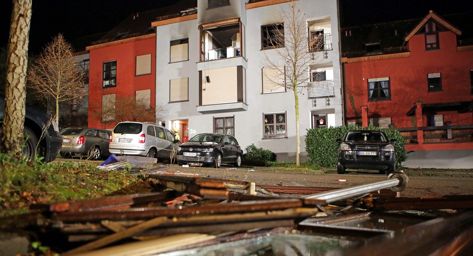epa05035140 Damage from an explosion in a second floor apartment lies on the street in front of the apartment building, in Karlsruhe, Germany, 20 November 2015. Three people have been found dead after an explosion, according to police.  EPA/Jodo-Foto / Joerg Donecke