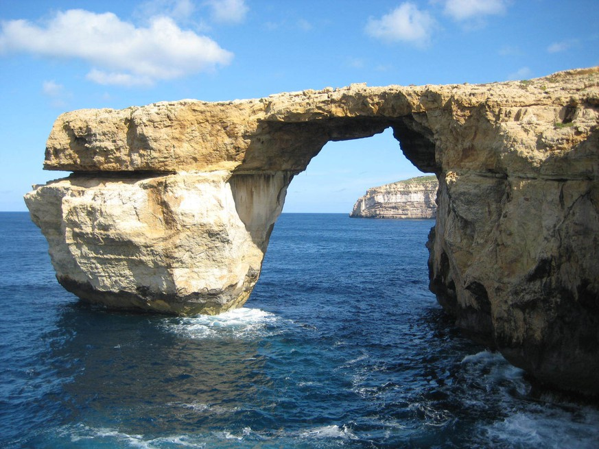 "This is a April 2014 image of the landmark the Azure Window located just off Malta.  The natural rock arch jutting off the Maltese island of Gozo, has collapsed into the sea during a storm. Malta's prime minister called the loss on Wednesday March 8, 2017, of the iconic limestone formation ""heartbreaking."" No one was injured by the fallen arch, which was also a TV and film backdrop.(Caroline Hodgson via AP)"