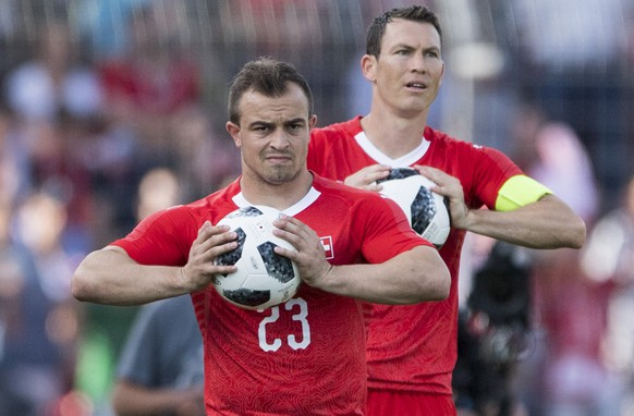 Switzerland's Xherdan Shaqiri, front, and Stephan Lichtsteiner, behind, with a ball problem during an international friendly soccer match in preparation for the upcoming 2018 Fifa World Cup in Russia between Switzerland and Japan at the Cornaredo stadium in Lugano, Switzerland, Friday, June 8, 2018. (KEYSTONE/Urs Flueeler)