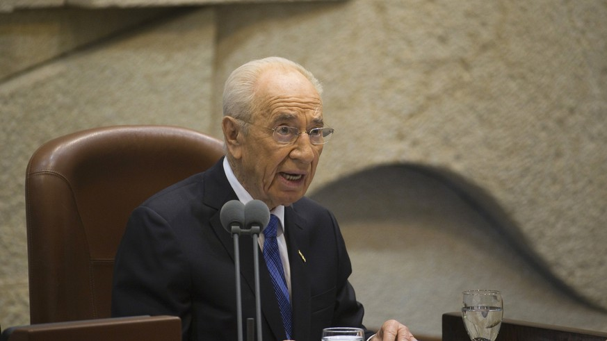 Outgoing Israeli President Shimon Peres speaks during the swearing-in ceremony of incoming President Reuven Rivlin at the Knesset, Israel's parliament, in Jerusalem, Thursday, July 24, 2014. Nobel Peace Prize laureate Shimon Peres ended his term as president of Israel on Thursday — a man who symbolizes hopes for peace capping a seven-decade public career amid the brutal reality of war. Peres handed the ceremonial but high-profile presidency over to Reuven Rivlin, a legislator from the hawkish Likud Party. (AP Photo/Ronen Zvulun, Pool)