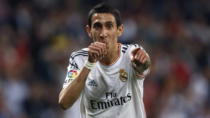 epa04369741 (FILE) A file picture of Real Madrid's midfielder Angel di Maria celebrating after scoring a goal against UD Almeria during the Spanish Primera Division soccer match between Real Madrid and Almeria, at Santiago Bernabeu stadium in Madrid, Spain, 12 April 2014.  As Manchester United announced, the club signes di Maria for British record fee of 75 million Euro. Di Maria joins on a five-year contract.  EPA/JAVIER LIZON