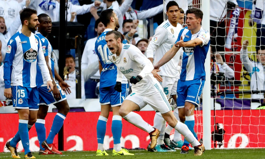 epa06461529 Real Madrid's Welsh winger Gareth Bale (C) celebrates after scoring his second goal during a Spanish league La Liga soccer match between Real Madrid and Deportivo at Santiago Bernabeu stadium in Madrid, Spain, 21 January 2018.  EPA/Juan Carlos Hidalgo