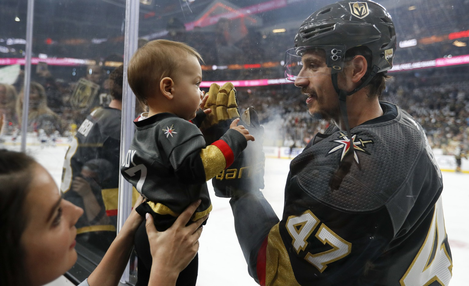 Vegas Golden Knights defenseman Luca Sbisa greets a young fan before Game 4 of the team's NHL hockey Western Conference finals against the Winnipeg Jets, Friday, May 18, 2018, in Las Vegas. (AP Photo/John Locher)