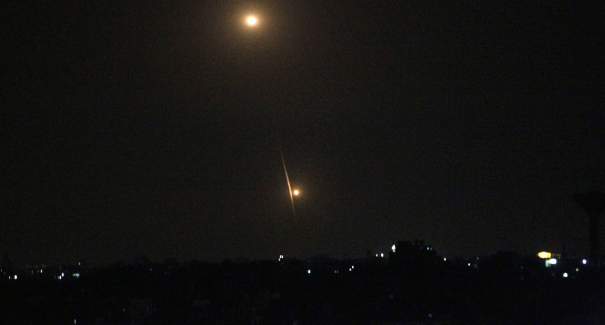 A picture taken from the southern Gaza Strip city of Rafah shows a long-range J-80 rocket being launched from the Gaza strip towards Israel on July 12, 2014 following an advance warning of the attack by Ezzedine al-Qassam Brigades, the military wing of Hamas. Gaza militants fired several rockets towards Jerusalem and Tel Aviv, the army said, with no reports of injuries, as Israel continued to bomb the coastal enclave. Three of the four Tel Aviv rockets were intercepted by the Iron Dome missile defence system, and the Jerusalem-bound rockets fell short, hitting two West Bank cities.   AFP PHOTO / SAID KHATIB