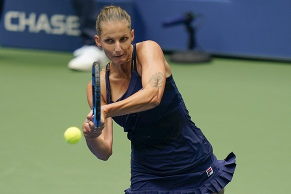 Karolina Pliskova, of the Czech Republic, returns a shot to Anhelina Kalinina, of the Ukraine, during the first round of the US Open tennis championships, Monday, Aug. 31, 2020, in New York. (AP Photo/Frank Franklin II)
