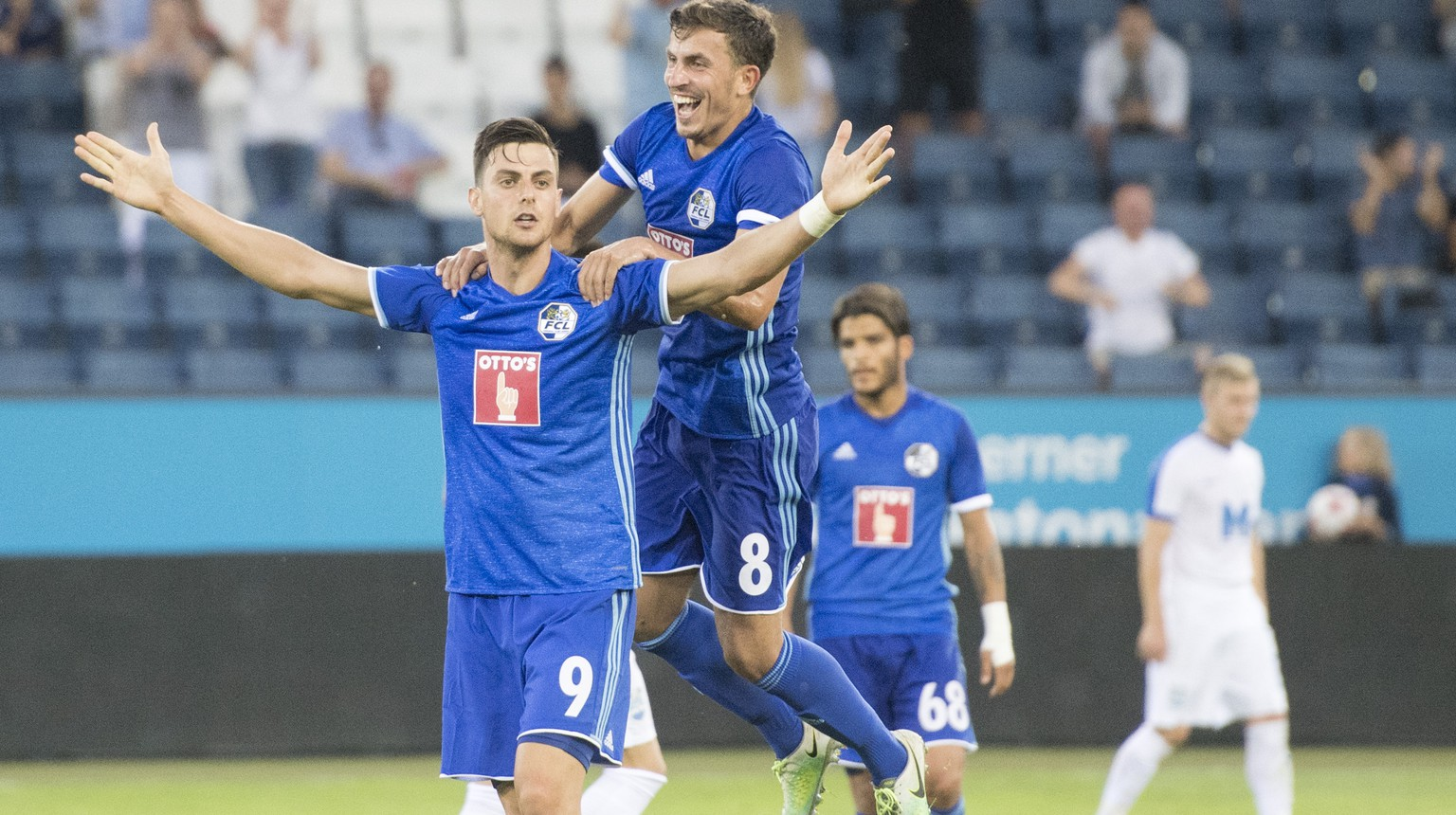 Tomi Juric, left, and Olivier Custodio, centre, from Luzern celebrate the Goal to the 2:0 during the UEFA Europa League qualifying second round soccer match between Switzerland's FC Luzern and Croatia's NK Osijek, in Lucerne, Switzerland, on Thursday, July 20, 2017. (KEYSTONE/Urs Flueeler)