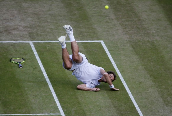 Richard Gasquet of France falls during his match against Stan Wawrinka of Switzerland at the Wimbledon Tennis Championships in London, July 8, 2015.                              REUTERS/Stefan Wermuth TPX IMAGES OF THE DAY