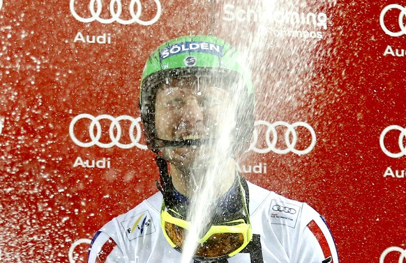 Alexander Khoroshilov of Russia celebrates with sparkling wine during the podium ceremony after winning the men's Alpine Skiing World Cup night slalom in Schaldming January 27, 2015.                              REUTERS/Dominic Ebenbichler (AUSTRIA  - Tags: SPORT SKIING)