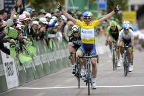 Switzerland's Michael Albasini of team Orica Greenedge of team Orica Greenedge celebrates as he cross the finish line to win the third stage, a 172,5 km race between Moutier and Porrentruy at the 69th Tour de Romandie UCI ProTour cycling race, in Porrentruy, Switzerland, Thursday, April 30, 2015. (KEYSTONE/Jean-Christophe Bott)