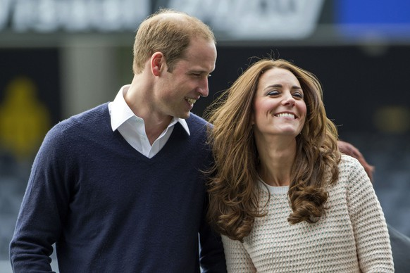Britain's Prince William and his wife Kate, the Duchess of Cambridge, visit a young players' rugby tournament, at Forsyth Barr Stadium, in Dunedin, New Zealand, Sunday, April 13, 2014.  (AP Photo/SNPA, David Rowland, Pool)