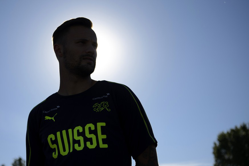 The silhouette of Switzerland's forward Haris Seferovic answering questions from journalists before a training session of the Switzerland's national soccer team at the Torpedo Stadium, in Togliatti, Russia, Monday, June 18, 2018. The Swiss team is in Russia for the FIFA World Cup 2018 taking place from 14 June until 15 July 2018. Team Switzerland is based in Togliatti in the Samara district. (KEYSTONE/Laurent Gillieron)