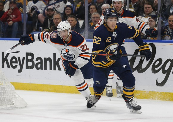 Buffalo Sabres defenseman Brandon Montour (62) skates past Edmonton Oilers forward Tobias Rieder (22) during the second period of an NHL hockey game, Monday, March 4, 2019, in Buffalo N.Y. (AP Photo/Jeffrey T. Barnes)