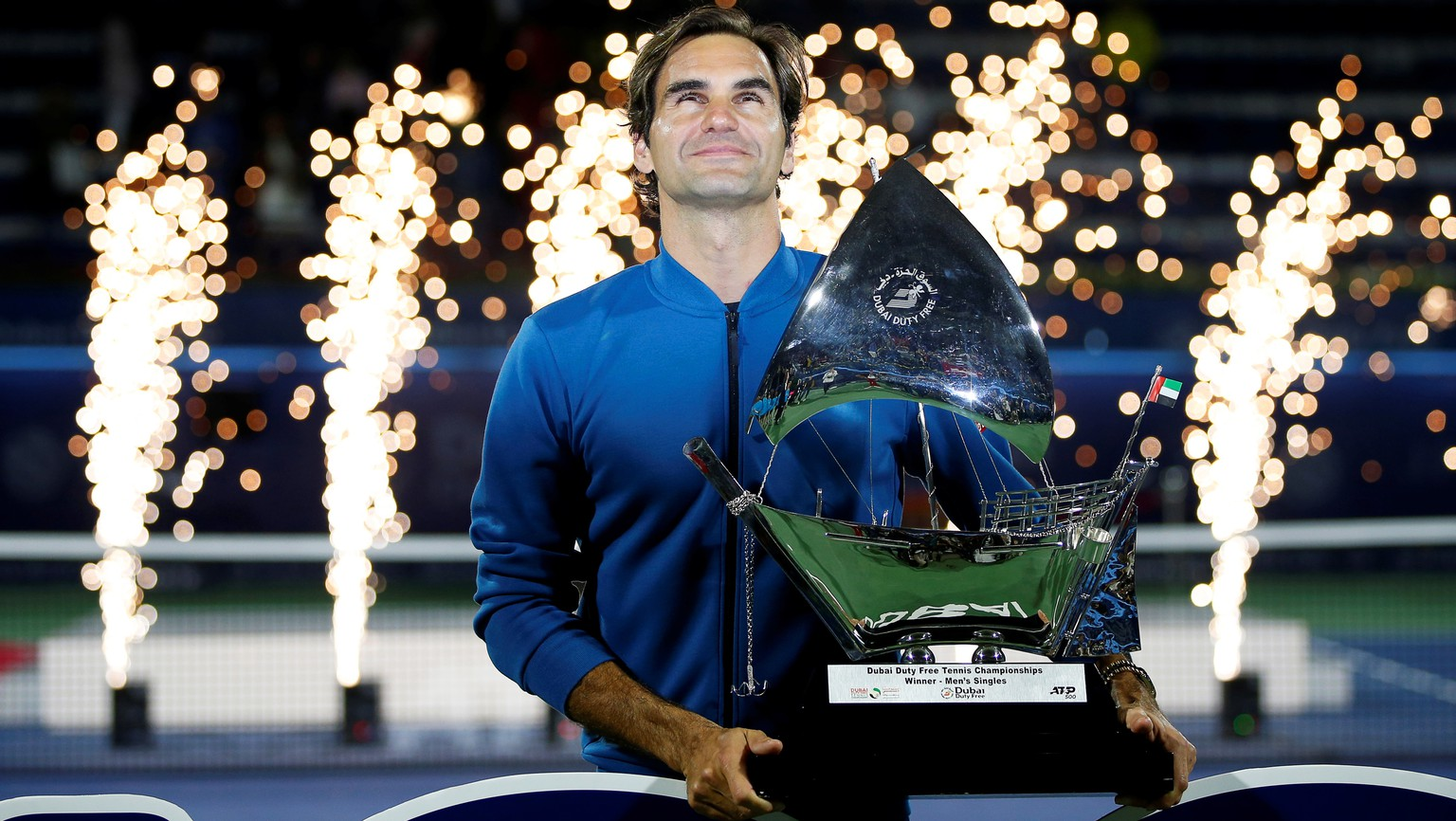 epa07409160 Roger Federer of Switzerland poses with his trophy after defeating Stefanos Tsitsipas of Greece in their final match at the Dubai Duty Free Tennis ATP Championships 2019 in Dubai, United Arab Emirates, 02 March 2019.  EPA/ALI HAIDER