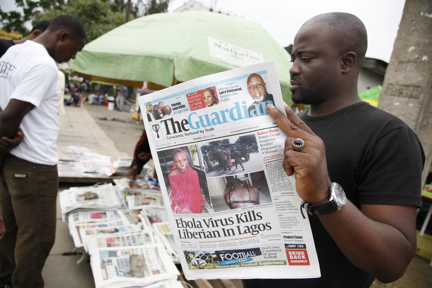 A man reads a local newspaperson a street with the headline Ebola Virus kills Liberian in Lagos, in Lagos Nigeria, Saturday, July 26, 2014. An Ebola outbreak that has left more than 600 people dead across West Africa has spread to the continent's most populous nation after a Liberian man with a high fever vomited aboard an airplane to Nigeria and then died there, officials said Friday. (AP Photo/Sunday Alamba)  The 40-year-old man had recently lost his sister to Ebola in Liberia, health officials there said. It was not immediately clear how he managed to board a flight, but he was moved into an isolation ward upon arrival in Nigeria on Tuesday and died on Friday. (AP Photo/Sunday Alamba)