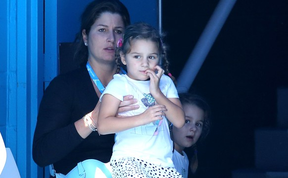 MELBOURNE, AUSTRALIA - JANUARY 18:  Mirka Federer, wife of Roger Federer of Switzerland and their children Charlene and Myla, watch him in his third round match against Teymuraz Gabashvili of Russia during day six of the 2014 Australian Open at Melbourne Park on January 18, 2014 in Melbourne, Australia.  (Photo by Michael Dodge/Getty Images)