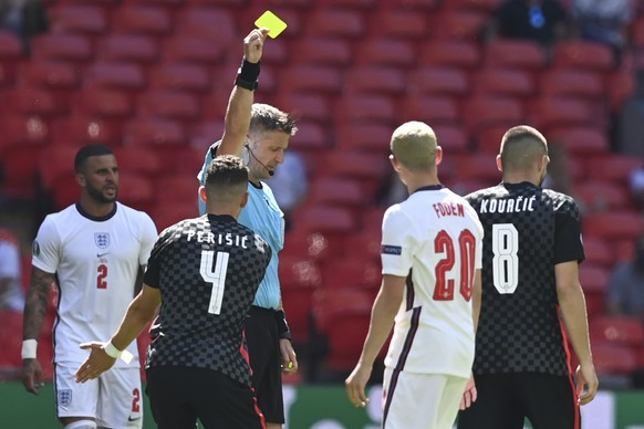 Italian referee Daniele Orsato, center, shows a yellow card to Croatia's Mateo Kovacic during the Euro 2020 soccer championship group D match between England and Croatia at Wembley stadium in London, Sunday, June 13, 2021. (Glyn Kirk/Pool Photo via AP)