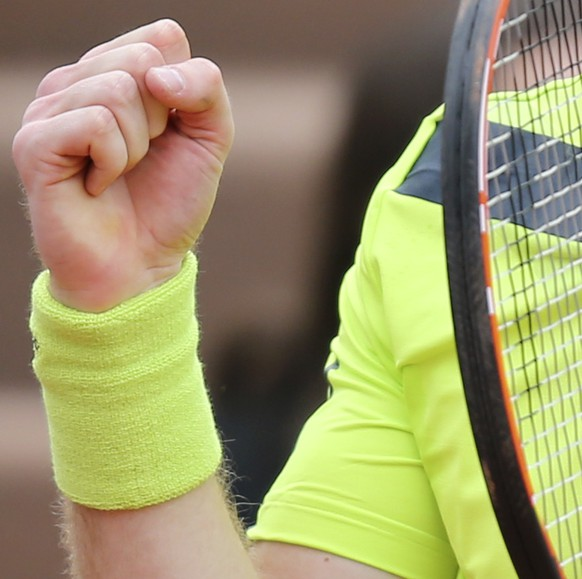 Britain's Andy Murray clenches his fist as he plays Kazakhstan's Andrey Golubev during the first round match of  the French Open tennis tournament at the Roland Garros stadium, in Paris, France, Tuesday, May 27, 2014. Murray won 6-1, 6-4, 3-6, 6-3. (AP Photo/David Vincent)