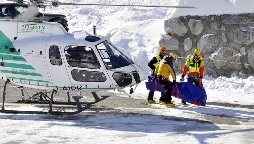 epa07342661 Recovery operations underway for the bodies of three free riders killed in an avalanche in Val Veny, identified as two British and a French, near the Alpine resort of Courmayeur, northwest Italy, 04 February 2019. The bodies of three people were found under an avalanche in the Canale degli Spagnoli, in Val Veny. Two British and two French skiers were reported missing on 03 February afternoon as high risk for avalanches was reported in the area. Searchers were said to be looking for the missing fourth skier.  EPA/THIERRY PRONESTI