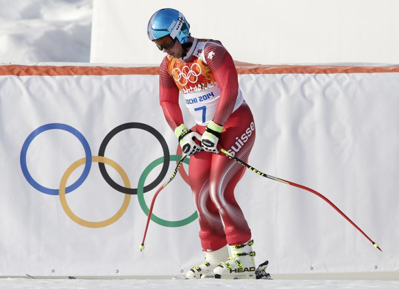 Switzerland's Beat Feuz pauses in the finish area at the end of his run in the men's super-G at the Sochi 2014 Winter Olympics, Sunday, Feb. 16, 2014, in Krasnaya Polyana, Russia. (AP Photo/Gero Breloer)