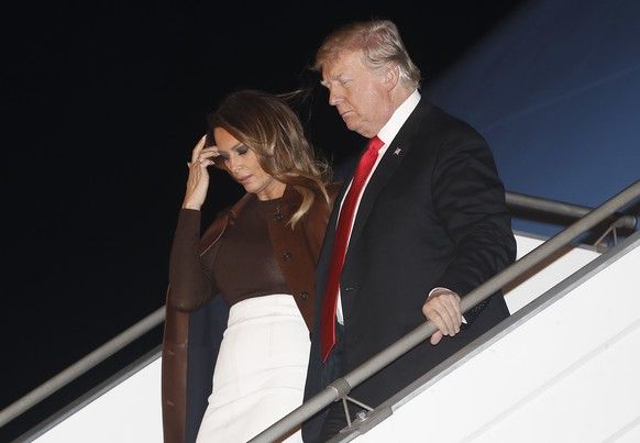 President Donald Trump and first lady Melania Trump walk from Air Force One, Thursday, Nov. 29, 2018, as they arrive at the Ministro Pistarini international airport in Buenos Aires, Argentina. Trump traveled to Argentina to attend the G20 summit. (AP Photo/Pablo Martinez Monsivais)