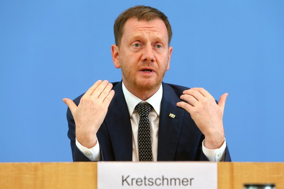 epa08524966 Minister-President of the German federal state of Saxony Michael Kretschmer gestures during a press conference in Berlin, Germany, 03 July 2020. The legislators in Germany's lower house of parliament decided the phase-out of coal based energy in Germany, with a deadline of the year 2038, distribution of aid and budget to localities affected by the phase-out and possible compensation to the coal-based energy production companies.  EPA/Mika Schmidt / POOL Pool Photo